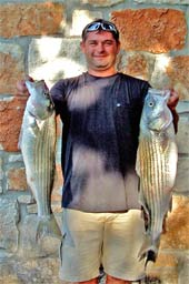 Mike Griffin holds a couple of nice sized Striped Bass.